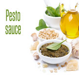 Pesto sauce in a bowl and ingredients, isolated Stock Photos