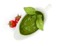 Pesto sauce and cherry tomatoes Royalty Free Stock Photography
