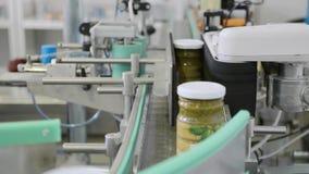 Pesto sauce on a conveyor belt
