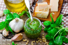 Pesto sauce in a glass jar Stock Images