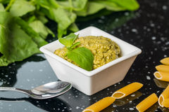 Pesto sauce in a gravy boat Stock Photography