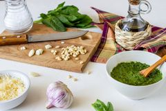 Pesto sauce and ingredients on a white background. Italian cuisine. Vegetarian food. The diet royalty free stock images