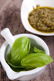 Pesto sauce ingredients. On wooden table Royalty Free Stock Photography