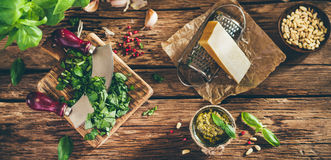 Pesto sauce and ingredients on old wooden table Royalty Free Stock Image