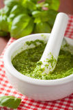 Pesto sauce and ingredients over red napkin Stock Photo