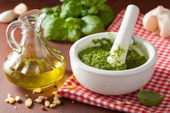 Pesto sauce and ingredients over wooden rustic background Stock Photos