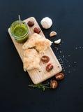 Pesto sauce in jar, ciabatta bread, cherry Royalty Free Stock Photos