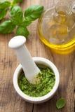 Pesto sauce in mortar Stock Photos