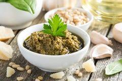 Pesto sauce in a white bowl Stock Photo