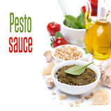 Pesto sauce in a white bowl and ingredients, isolated Stock Photos
