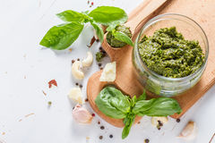 Pesto sause and ingredients on white background Stock Photo
