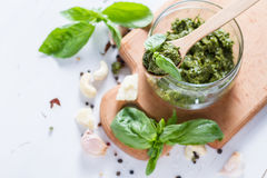 Pesto sause and ingredients on white background Stock Image