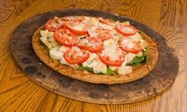 Pesto Spinach Tomato Pizza Royalty Free Stock Photography