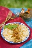Pesto Vegan Blend. Basil, garlic, pine nuts, sun-dried tomato sprinkled on pasta stock photos