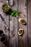 Pesto, wine and two slices of baquette on the table. Stock Photos