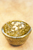 Pesto on wooden background Royalty Free Stock Image