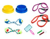 Pet accessories on isolated white background. Brush, rubber toys, bowl and collars for dog stock photos
