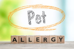 Pet allergy sign on a wooden desk Stock Images