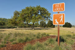 Pet Area sign in field near a tree Royalty Free Stock Photo