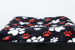 Bed for pet in neutral background. Pet bed texture and print with dog tracks, bed on neutral background royalty free stock images