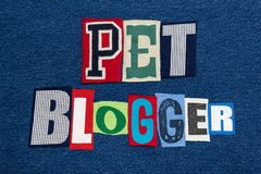 PET BLOGGER text word collage colorful fabric on blue denim, animals and pets blogs and blogging