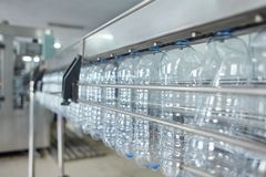 Pet bottle with natural water manufacturing. Soft focus. Water factory stock images