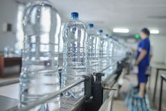 Pet bottle with natural water manufacturing. Soft focus. Water factory stock photos