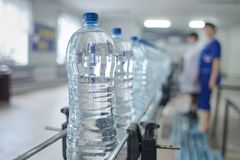 Pet bottle with natural water manufacturing. Soft focus. Water factory royalty free stock photo