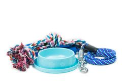 Pet bowls, Rope and Leash with hook on isolated white. Pet supplies concept stock photo