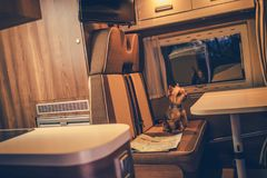 Pet in a Camper RV Motorhome. Australian Silku Terrier in the Camper Van Seating Next to Map Royalty Free Stock Photo