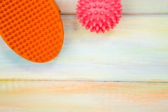 Pet care concept. With bright rubber brush and ball wooden background, top view Royalty Free Stock Image