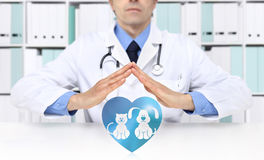 Pet care concept veterinarian hands with animal icons Royalty Free Stock Photo