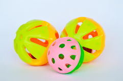 Pet colorful plastic toy ball and bell on white background Stock Image