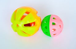 Pet colorful plastic toy ball and bell on white background Royalty Free Stock Images