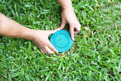 Pet control puttine Termite bait system in to the ground. Pet control putting Termite bait system in to the ground in the blue lid stoping termite damage the Royalty Free Stock Photo