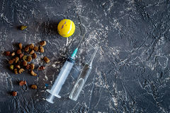 Pet cure concept. Ampoule, syringe and animal feed on grey stone background top view copyspace Royalty Free Stock Image
