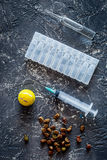 Pet cure concept. Ampoule, syringe and animal feed on grey stone background top view Royalty Free Stock Images
