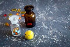 Pet cure concept. Pills on grey stone background top view copyspace Stock Image