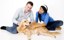 Pet Dog. A young couple with their pet golden retriever Stock Photography