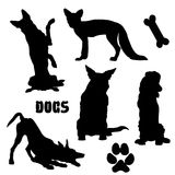 Pet dogs, black silhouette - vector collection. Dogs, black silhouette on white isolated Royalty Free Stock Photography