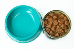 Pet food. Cat food in a can and a feeding barge Stock Photography