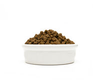 Pet food. Bowl with pet food on white background Royalty Free Stock Image