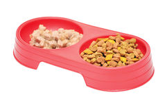 Pet food. In a red bowl Stock Photos