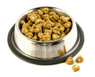 Pet food Bowl. Shiny bowl full of heart shaped pet food royalty free stock photo