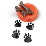 Pet food bowl and footprints Stock Images