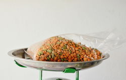 Pet food in plastic bag on weighting scale tray Stock Photo