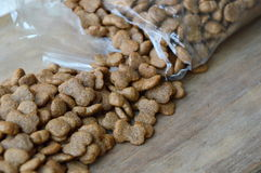 Pet food pour from plastic bag Stock Images