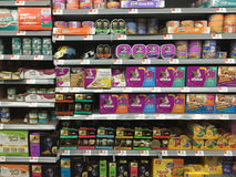Pet food on shelves Stock Photography