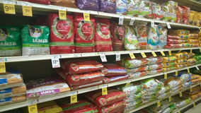 Pet food on shelves Stock Image