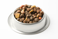 Pet food in silver bowl Royalty Free Stock Images